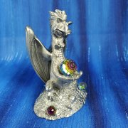 Dragon Sitting on Treasure with Crystal Ball